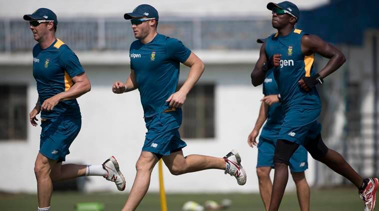 South African cricket players, from left to right, Kyle Abbott, David Miller and Kagiso Rabada, run during a practice session in New Delhi, India, Monday, Sept. 28, 2015. South Africa will play three Twenty20 internationals, five one-day internationals and four Tests during their 72-day tour of India. (AP Photo/Tsering Topgyal)