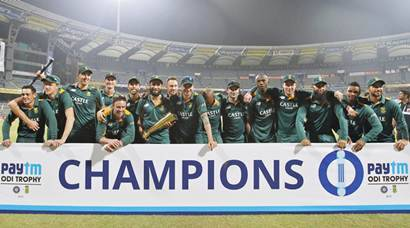 South Africa's players pose with their trophy after winning their fifth and final one-day international cricket match against India in Mumbai