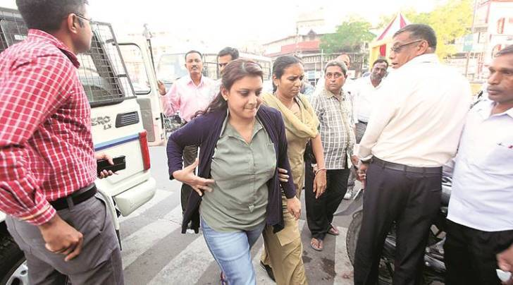 Vadodara police produce Maria Susairaj in court, seeking custody on Friday in the fraud of Rs 2.11cr. (Express Photo by Bhupendra Rana)