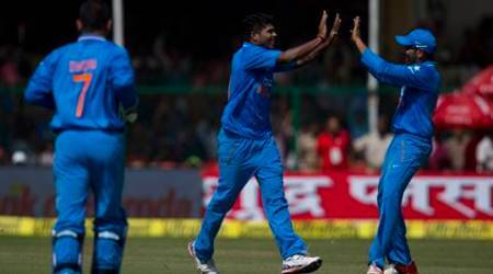 Indian bowler Umesh Yadav, center, celebrates with teammates after claiming a South African wicket in the first of their five one-day match series in Kanpur, India, Sunday, Oct. 11, 2015. (AP Photo/Saurabh Das)