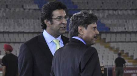 Kapil Dev with Wasim Akram during CLT20 match played at PCA Stadium in Mohali on Tuesday, September 17 2013. Express Photo by Kamleshwar Singh