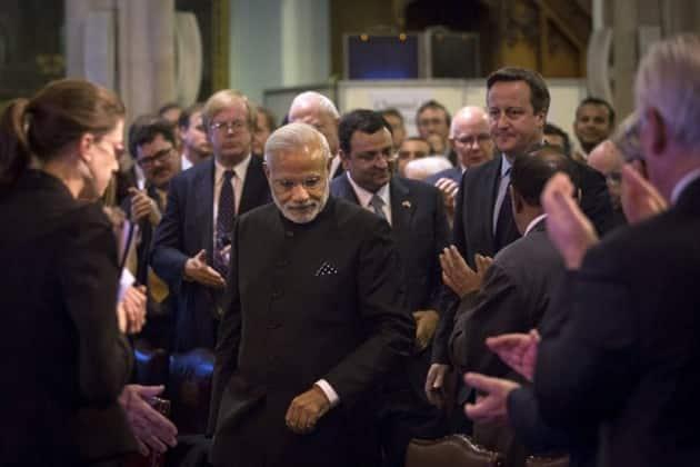 Narendra Modi, David Cameron, Modi in UK, Modi UK visit, Modi UK photos, Modi visits UK, Modi London protest, Modi Cameron, Modi 10 downing street, modi david, modi united kingdom, India UK relationship, Modi UK pictures, World news