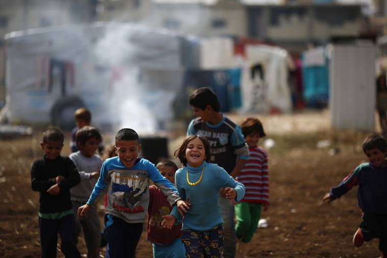 Syrian refugee boys play at a refugee camp in the town of Hosh Hareem, in the Bekaa valley, east Lebanon, Wednesday, Oct. 28, 2015. The United Nations said Tuesday the worsening conflict in Syria has left 13.5 million people in need of aid and some form of protection, including more than six million children. AP Photo/Hassan Ammar