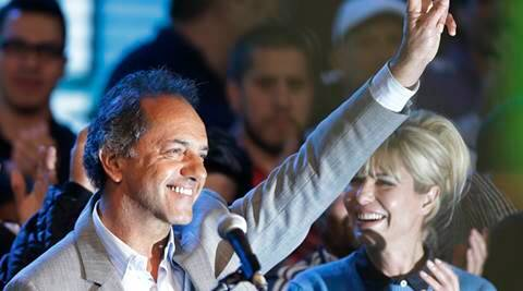 Ruling party presidential candidate Daniel Scioli makes a victory sign during a closing campaign rally in La Matanza, in the outskirts of Buenos Aires, Argentina, Thursday, Nov. 19, 2015. Scioli will face opposition candidate Mauricio Macri in a Nov. 22 runoff. (AP Photo/Ricardo Mazalan)