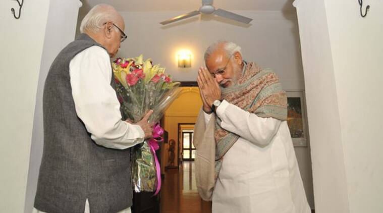 Prime Minister Narendra Modi presenting a bouquet to L K Advani wishing him on his birthday. (Source: @PIB_India)