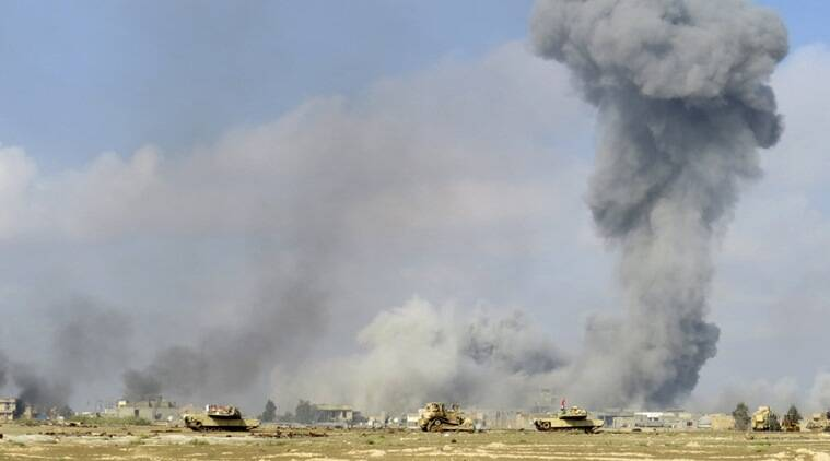 Smoke rises from Islamic State positions following a U.S.-led coalition airstrike while Iraq anti-terrorism forces advance their position during clashes with Islamic State group in the western suburbs of Ramadi, the capital of Iraq's Anbar province, 70 miles (115 kilometers) west of Baghdad, Iraq, Saturday, Nov. 21, 2015. (AP Photo/Osama Sami)