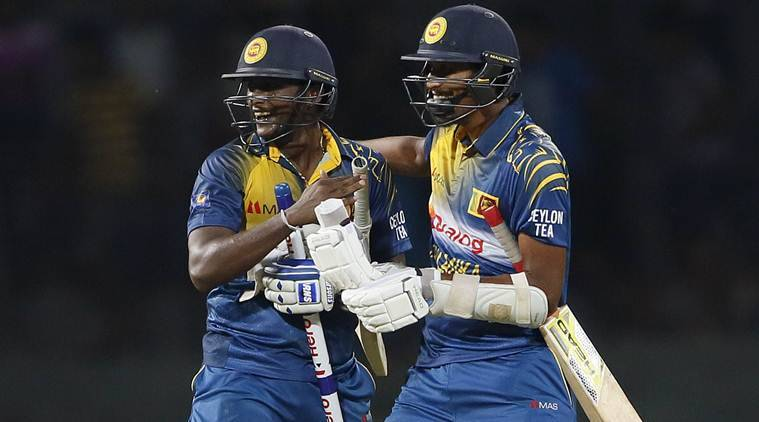 Sri Lanka's Ajantha Mendis (L) and Sachithra Senanayake celebrate after winning their One Day International cricket match against West Indies in Colombo November 1, 2015. REUTERS/Dinuka Liyanawatte
