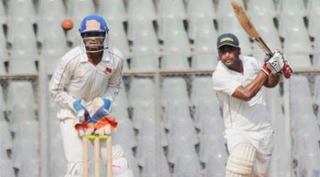 Mumbai: Arindam Ghosh of Railways hit a shot against Mumbai at Wankhede Stadium in Mumbai on Sunday.  PTI Photo (PTI11_15_2015_000183B)