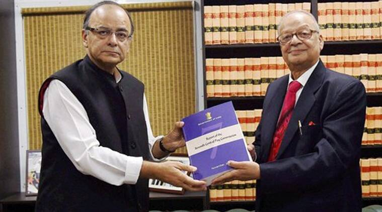 Finance Minister Arun Jaitley receiving the report of Seventh Pay Commission from its Chairman Justice A K Mathur in New Delhi.