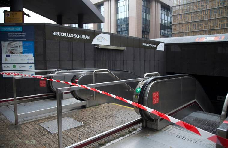 Police tape blocks the entrance of a metro station in Brussels. Belgium raised its security level to the highest degree on as the manhunt continues for extremist Salah Abdeslam who took part in the Paris attacks. (AP Photo/Virginia Mayo)