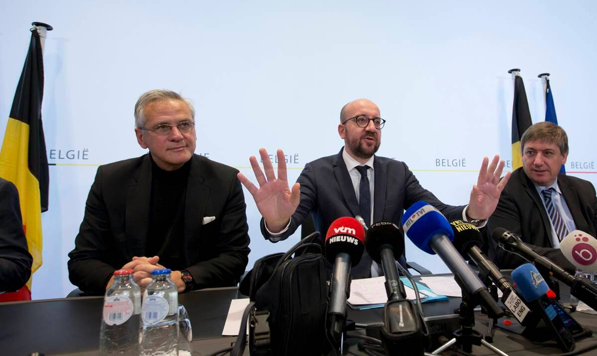 Belgian Prime Minister Charles Michel, center, gestures before addressing a media conference at the prime minister's office in Brussels. (AP Photo/Virginia Mayo)