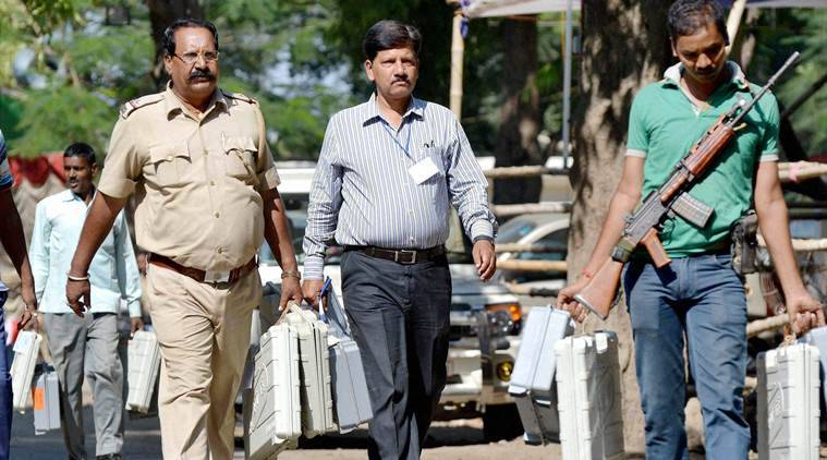 Muzaffarpur:Police persons carry EVMa ahead of polling of the 4th phase of Bihar assembly polls in Muzaffarpur on Saturday. PTI photo(PTI10_31_2015_000296B)