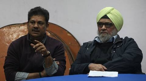 Former cricketer Kirti Azad and Bishan Singh bedi during Delhi Ranji trophy match against Odisha, at Feroz shah Kotla stadium in New Delhi. Express Photo by Amit Mehra. 14.01.2015.