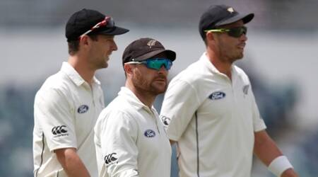 New Zealand's Brendon McCullum, center, walks off the ground after Australia declared on the final day during their cricket test match in Perth, Australia, Tuesday, Nov. 17, 2015. (AP Photo/Theron Kirkman)