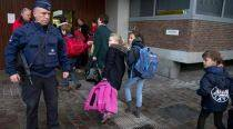Brussels schools reopen, authorities still fear imminent attack