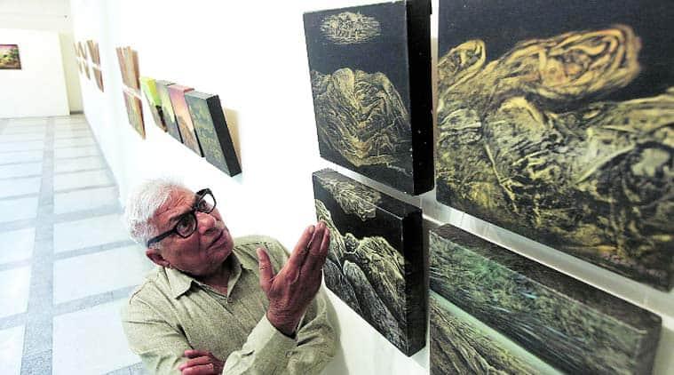 Baldev Gambhir with his painting at Punjab Kala Bhawan in Sector 16, Chandigah, on Thursday. Jaipal Singh