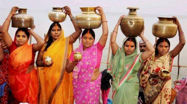 Devotees carry holy Ganga water ahead of Chhath Puja, in Patna on Monday. (Source: PTI)