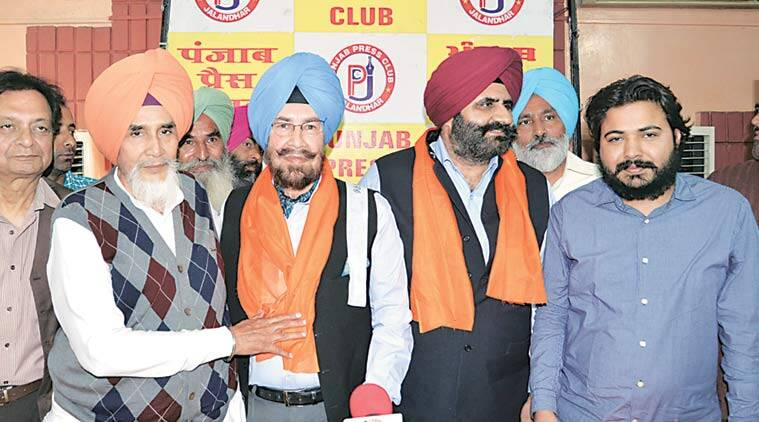 AAP convenor Sucha Chhotepur (extreme left) with Col C D Kamboj (retd) in Jalandhar on Tuesday. (Express Photo)