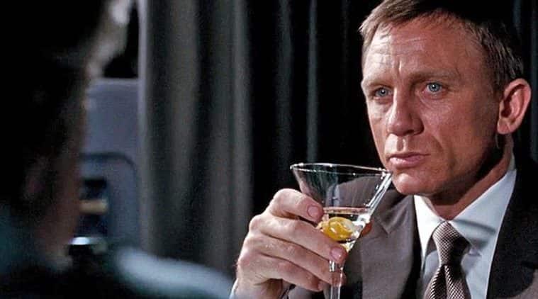 Daniel Craig drinking a dry martini.