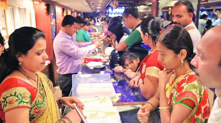 People shopping for gold at Lakshmi Road on Monday on the occasion of Dhanteras. (Tanmay Thombre)