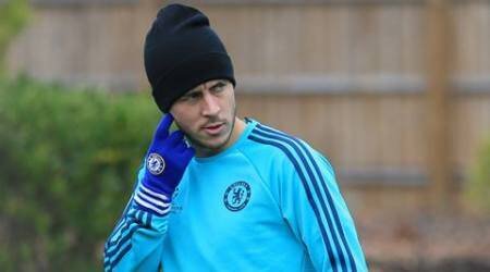 Chelsea's Eden Hazard arrives on the field during a training session at the team's training ground in Cobham, England, Tuesday Nov. 3, 2015. Chelsea will play Dynamo Kyiv in a Group G match on Wednesday. (AP Photo/Tim Ireland)