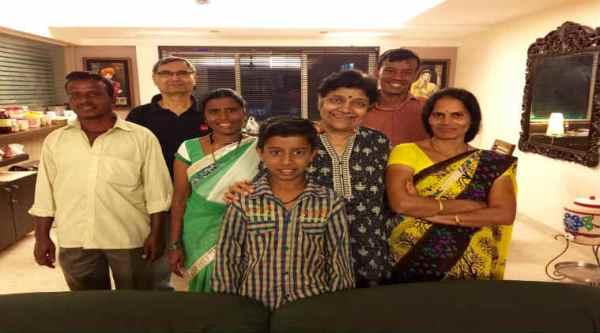 Nithya Shanti's family posing with the maid's family/ Nithya Shanti's Facebook page