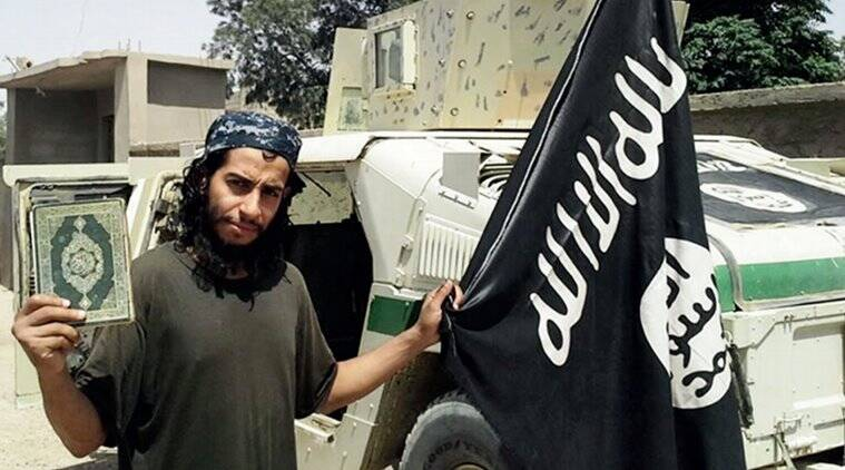 This undated image made available in the Islamic State's English-language magazine Dabiq, shows Belgian national Abdelhamid Abaaoud. Abaaoud, the child of Moroccan immigrants who grew up in the Belgian capital's Molenbeek-Saint-Jean neighborhood, was identified by French authorities on Monday Nov. 16, 2015, as the presumed mastermind of the terror attacks last Friday in Paris that killed over a hundred people and injured hundreds more. (Militant Photo via AP)