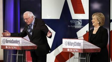 Hillary Rodham Clinton, right, laughs as Bernie Sanders speaks during a Democratic presidential primary debate in Des Moines, Iowa. AP Photo