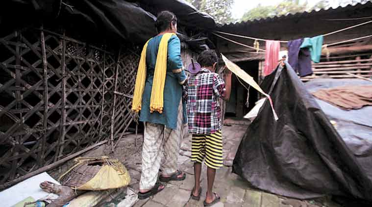 The boy, his  mother at their home in Bishnupur in South 24 Parganas. (Express Photo by: Subham Dutta)
