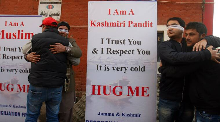People hug each other during mega 'Hug Campaign' to promote universal brotherhood, interfaith dialogue, tolerance and bridge the gap between people of different communities within the state of J&K organised by Jammu and Kashmir Reconciliation front, in Srinagar on Monday. (Source: Express photo by Shoaib Masoodi)