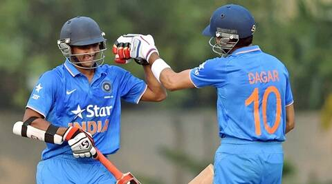 Kolkata: India U-19 batsmans M K Lomror and M J Dagar greets each other after they wins by 4 Wickets against Bangladesh during Tri-series U-19 Cricket Tournament in Kolkata on Tuesday. PTI Photo by Swapan Mahapatra(PTI11_24_2015_000224A)