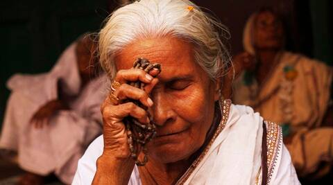 A Hindu widow offers prayers at a Dharamsala, or rest house for pilgrims, on the first day of the five-day long Panchuka festival in Bhubaneswar, in the eastern Indian state of Orissa, Friday, Nov. 20, 2015. Widows from across the state gather to perform rituals for their salvation and for the souls of their departed husbands during this auspicious festival. (AP Photo/Biswaranjan Rout)