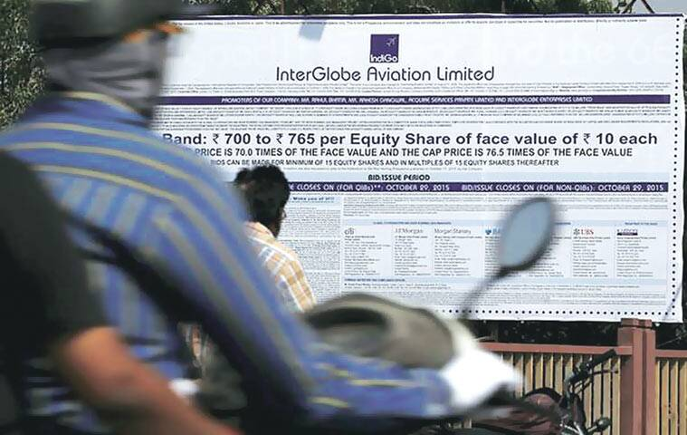 Commuters move past an advertisement of IndiGo Airlines in Ahmedabad. (Source: Reuters)