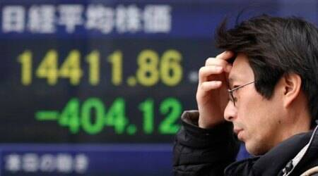 Japan economy slips back into recession in July-Sept, blow toAbenomics