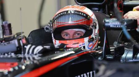McLaren Honda driver Jenson Button of Britan sits inside his car as he prepare to leave the pits during the third practice session for the Formula One Mexico Grand Prix auto race at the Hermanos Rodriguez racetrack in Mexico City, Saturday, Oct. 31, 2015. (AP Photo/Christian Palma)