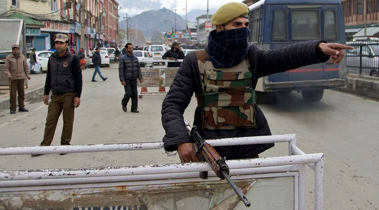 An Indian police man signals Kashmiri Muslims to stop at a temporary checkpoint in Srinagar, Indian controlled Kashmir, Wednesday, Nov. 4, 2015. Indian authorities have detained key separatist leaders and hundreds of their supporters to prevent them from protesting during Prime Minister Narendra Modi's visit to Kashmir this weekend. (AP Photo/Dar Yasin)