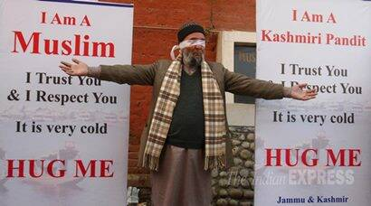 Blindfolded Kashmiri Pandit invites 'hugs' to promote brotherhood in Valley