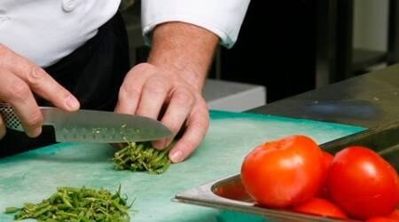Close up of a person chopping vegetables