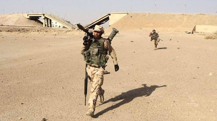 In this Friday, Oct. 16, 2015 photo, Iraqi security forces regain control of Tamim district in southern Ramadi. Security forces, backed by allied Sunni volunteer tribal fighters and supported by U.S.-led coalition airstrikes against Islamic State group advanced their position after clashes in southern Ramadi, the capital of Iraq's Anbar province, 70 miles (115 kilometers) west of Baghdad, Iraq. (AP Photo)