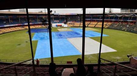 Bengaluru : Ground covered with sheets as it rains during the 3rd day of the second test match between India and South Africa at Chinnaswamy Stadium in Bengaluru on Monday. PTI Photo by Shailendra Bhojak  (PTI11_16_2015_000053A)