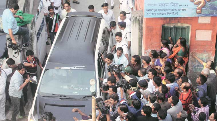 Madan Mitra on way to surrender at the Alipore court, in Kolkata on Thursday. (Source: Express Photo by Partha Paul)