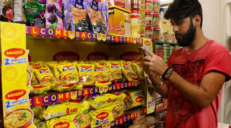 Few stores got the shipment today in Mumbai. A man takes photographs of the relaunched Maggi noodles at Society stores in Lokhandwala, Andheri (W). (Source: Express photo)