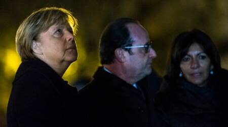 From left, German Chancellor Angela Merkel, French president Francois Hollande and Paris Mayor Anne Hidalgo pay their respects to the victims of the attacks of the 13th November on the Place de la Republique prior to a meeting at the Elysee Palace, in Paris, Wednesday, Nov. 25, 2015. Merkel's visit to Paris is part of president Hollande's diplomatic offensive to get the international community to bolster the campaign against the Islamic State militants. (Etienne Laurent, Pool Photo via AP)