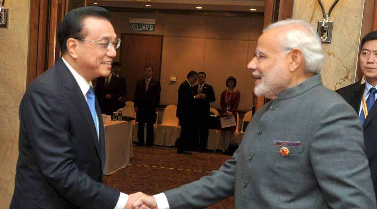 Prime Minister Narendra Modi shakes hands with Chinese Premier Li Keqiang at a meeting in Kuala Lumpur. (Source: PTI)