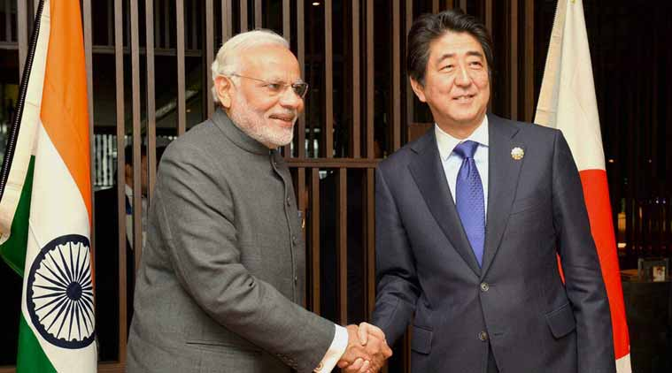 Prime Minister Narendra Modi shakes hands with his Japanese counterpart Shinzo Abe at a meeting in Kuala Lumpur. (Source: PTI)
