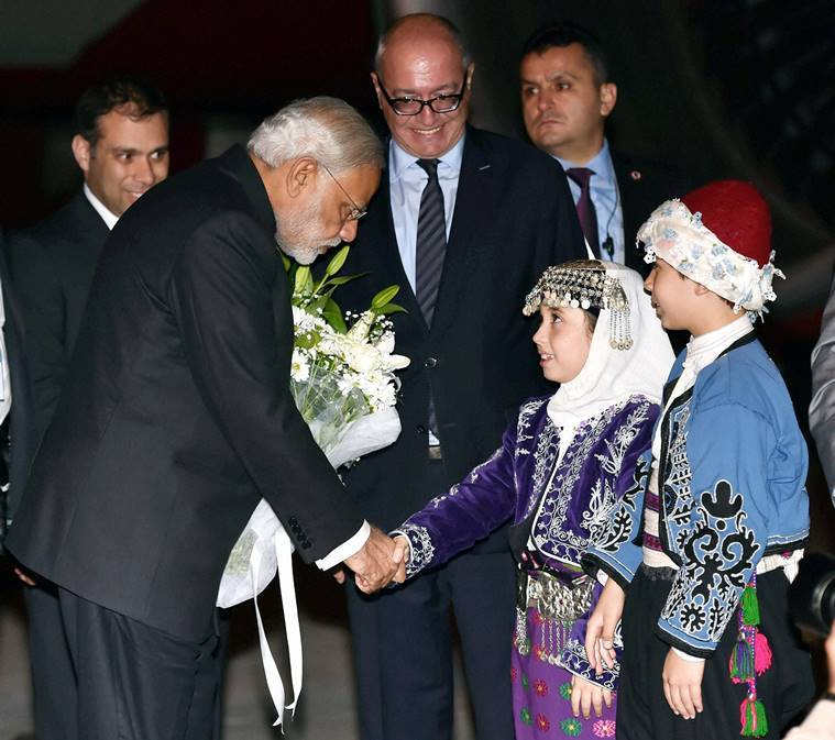 Prime Minister Narendra Modi being welcome by Turkish children on his arrival at Antalya airport in Turkey on Saturday night. AP Photo