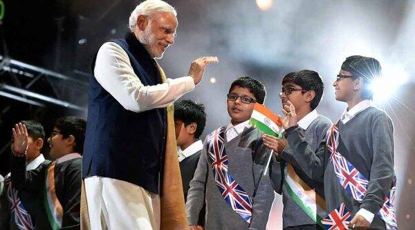 London: Prime Minister Narendra Modi  interact with school childrens at Wembley Stadium for addressing Indian Community in London on Friday. PTI Photo by Vijay Verma(PTI11_13_2015_000314A)