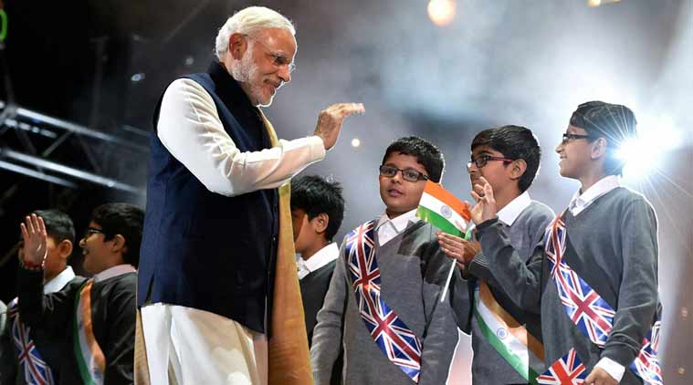 Modi interacts with school childrens at Wembley Stadium. (Source: PTI)