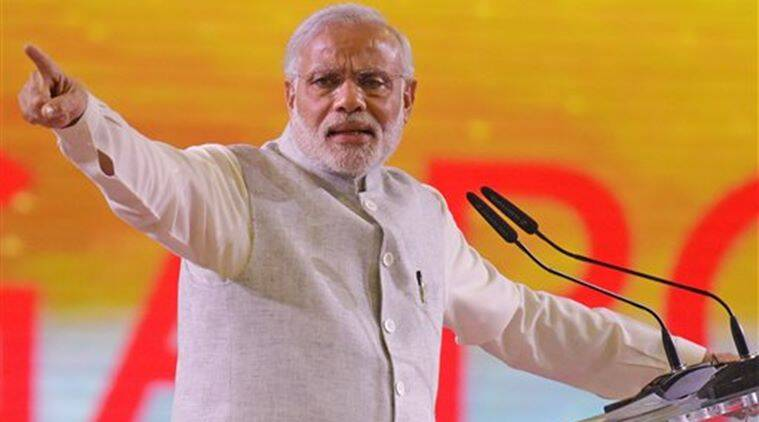 Prime Minister Narendra Modi delivers a public speech to a crowd of mostly Indian nationals at the Singapore Expo. (AP Photo)