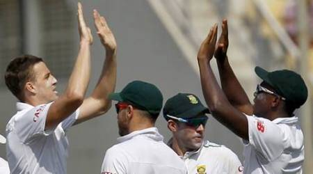 South Africa's Morne Morkel (L) celebrates with his teammates after taking the wicket of India's Ajinkya Rahane (not pictured) on the first day of their third test cricket match in Nagpur, India, November 25, 2015.  REUTERS/Amit Dave